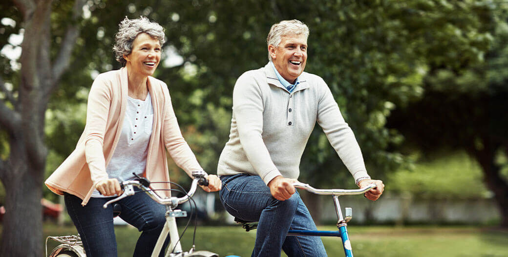 couple riding a bike outside with dentures in Columbia, South Carolina